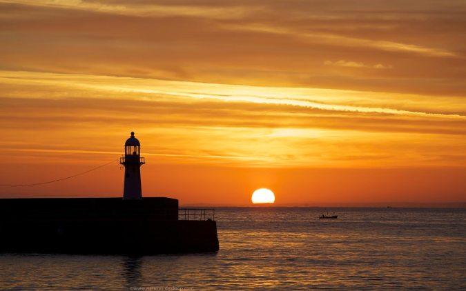 Ocean Sunrise and Lighthouse