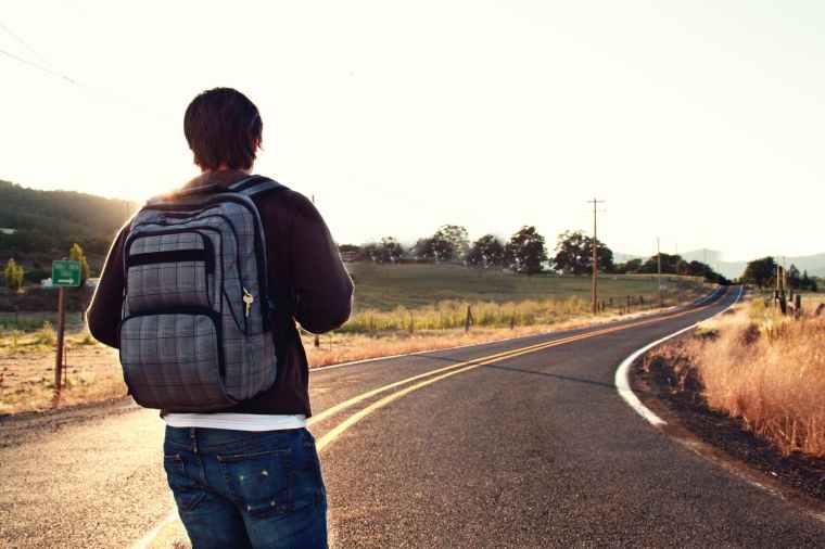 man facing road